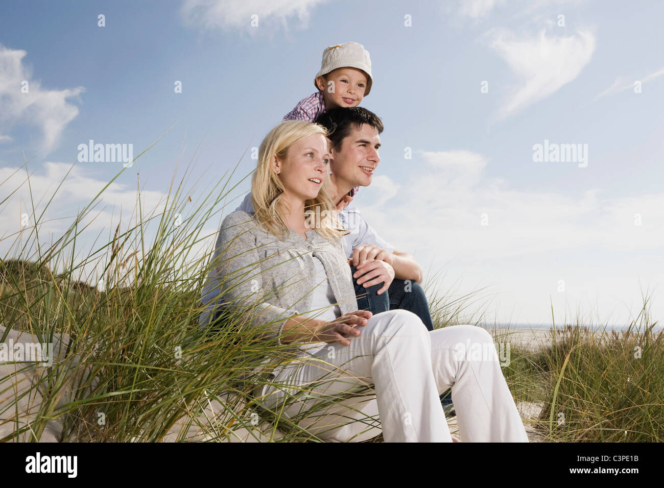 Germany, Schleswig Holstein, Amrum, familiy in the dunes - Stock Image