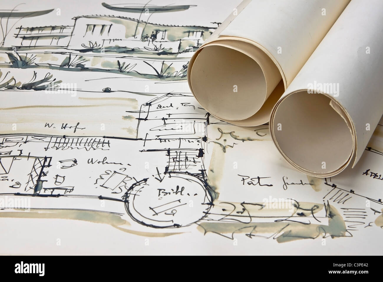 the blueprint of a house with two paper rolls - Stock Image