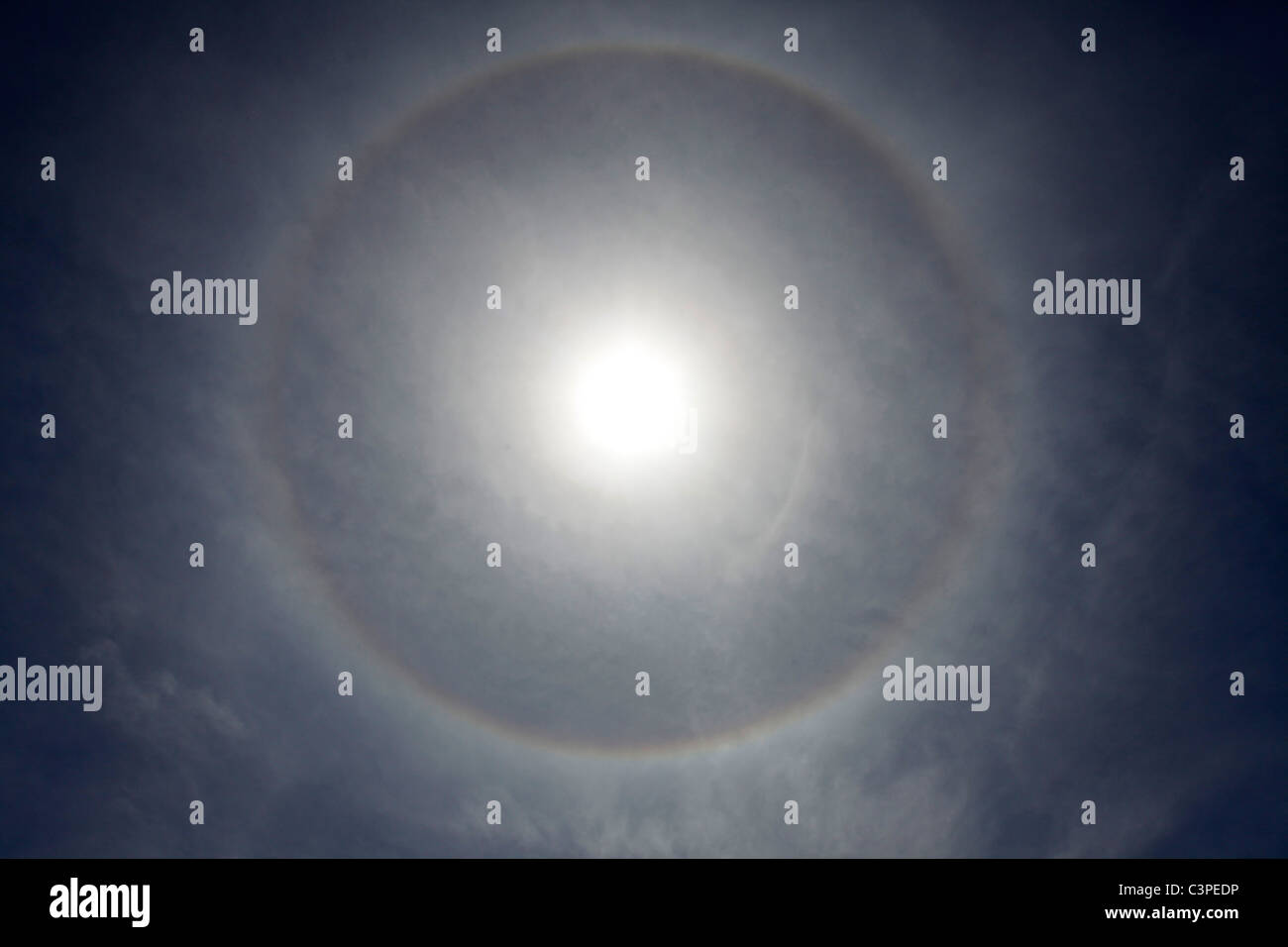 A halo appears around the sun. - Stock Image
