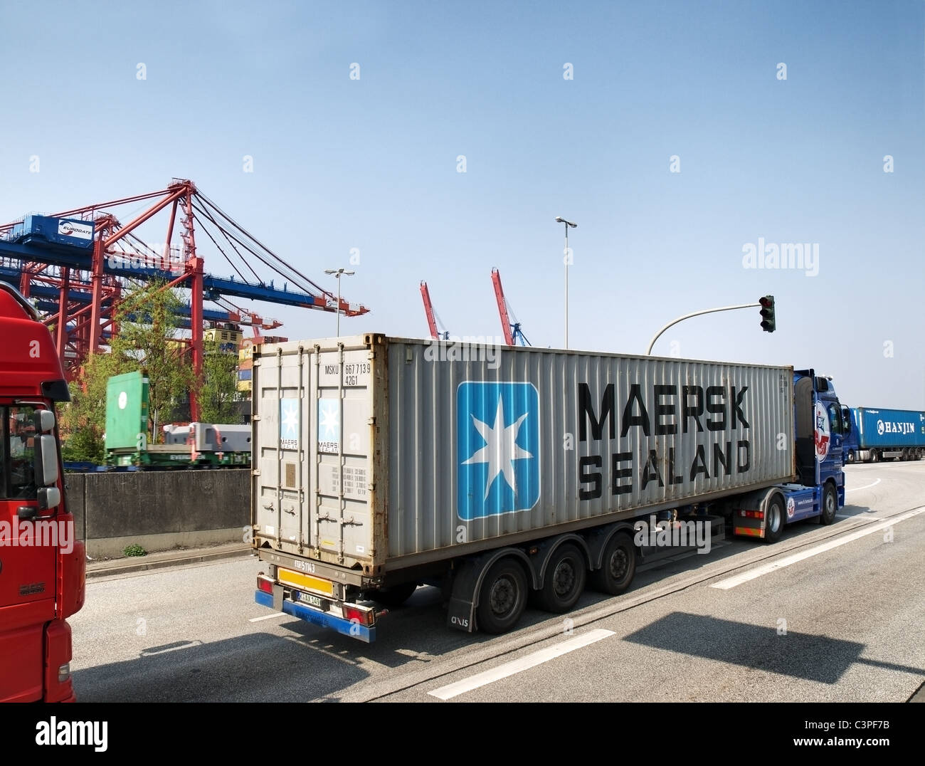Truck with Maersk Sealand 40' container approaching the container terminal Burchardkai in the Port of Hamburg, - Stock Image