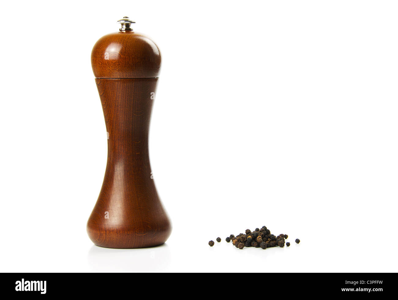 Black pepper and a pepper mill - Stock Image