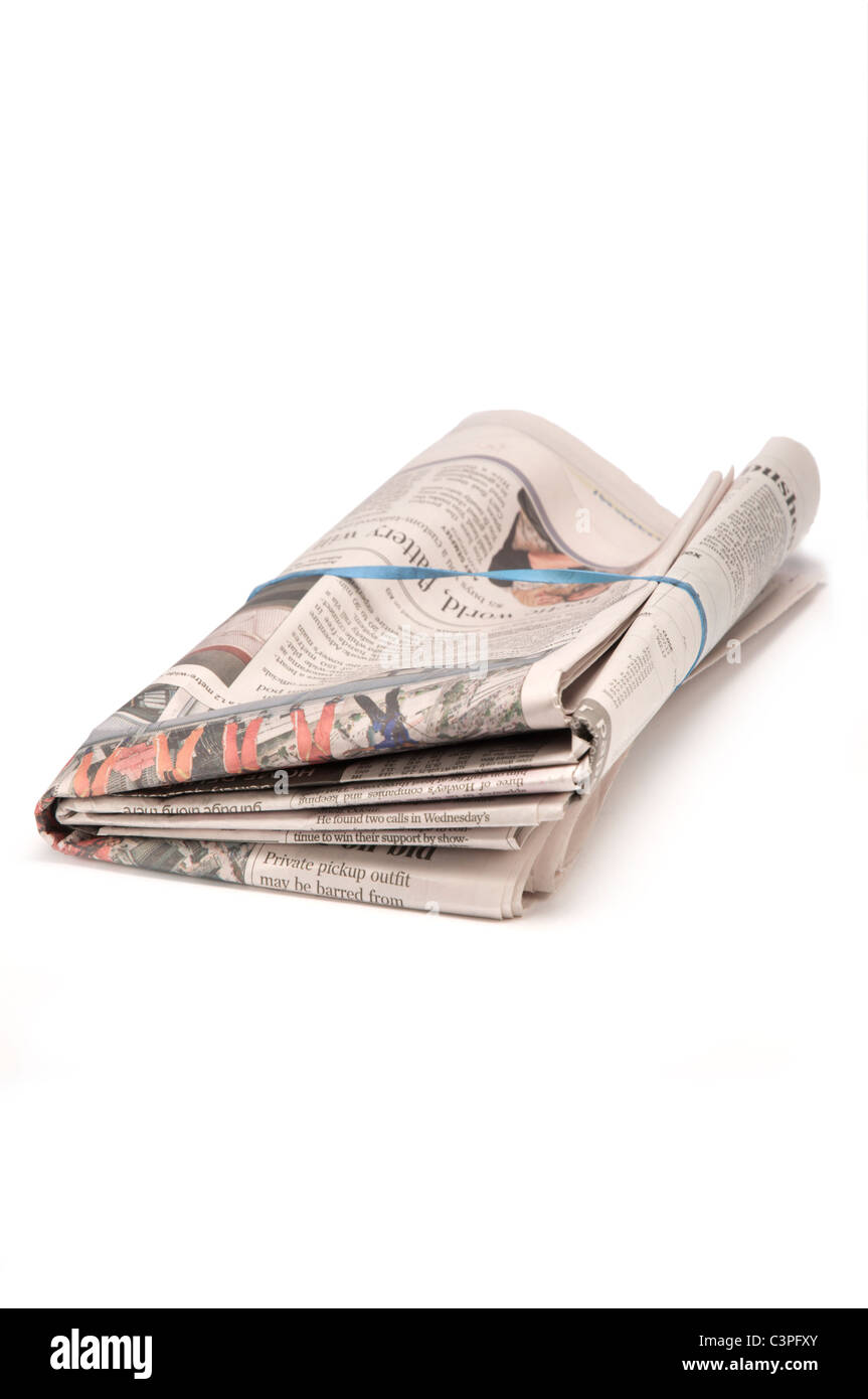 Folded delivered newspaper om white - Stock Image