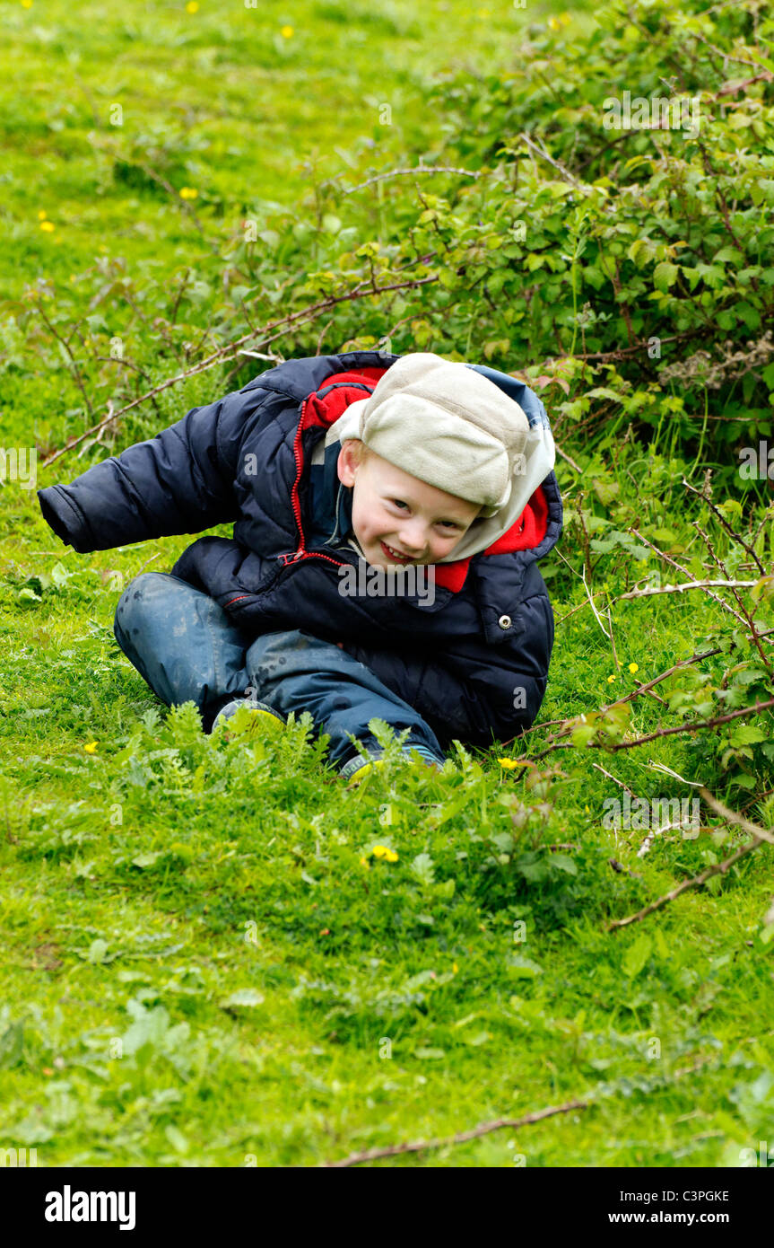 A young boy playing hide and seek. Stock Photo