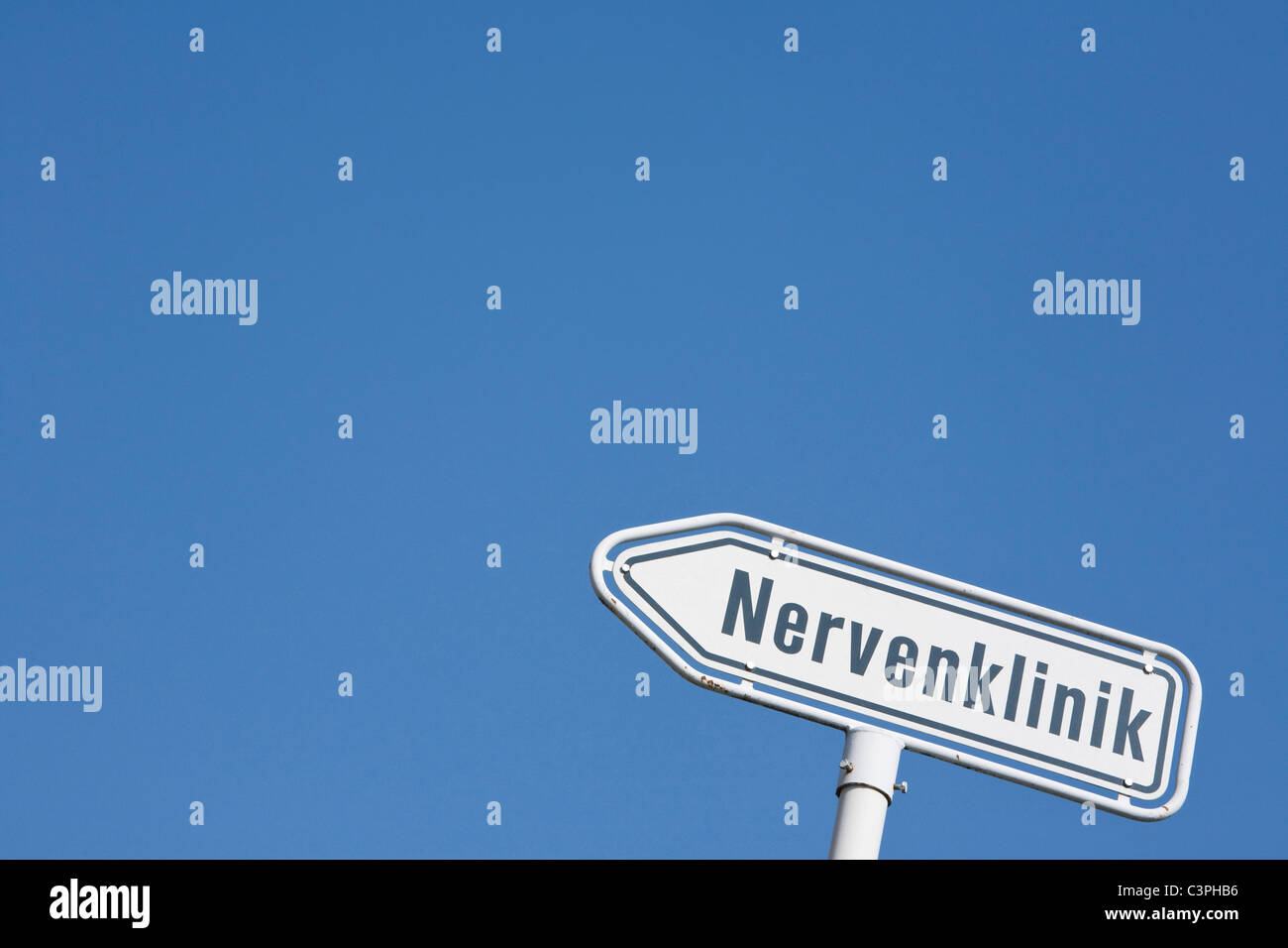 Germany, Direction sign to psychiatric clinic - Stock Image