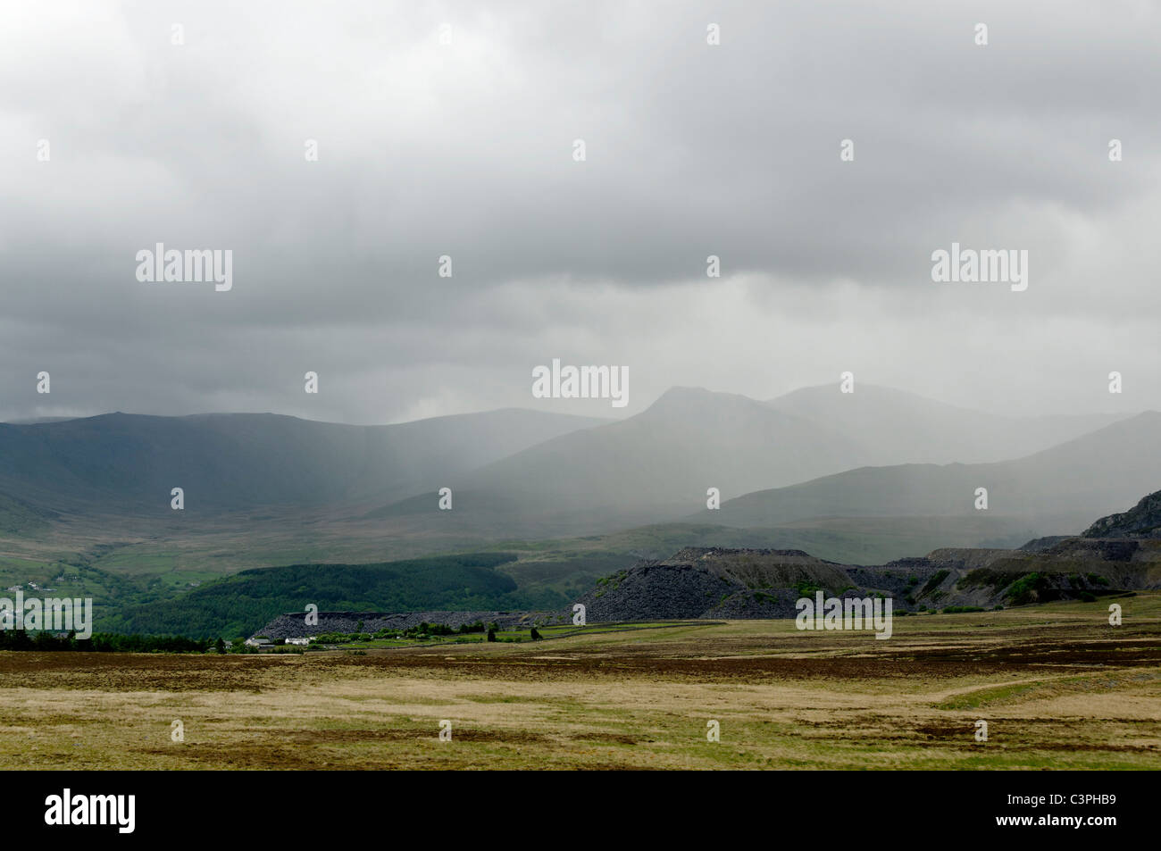 A large rain cloud crossing the Carneddau mountains in Snowdonia, - Stock Image