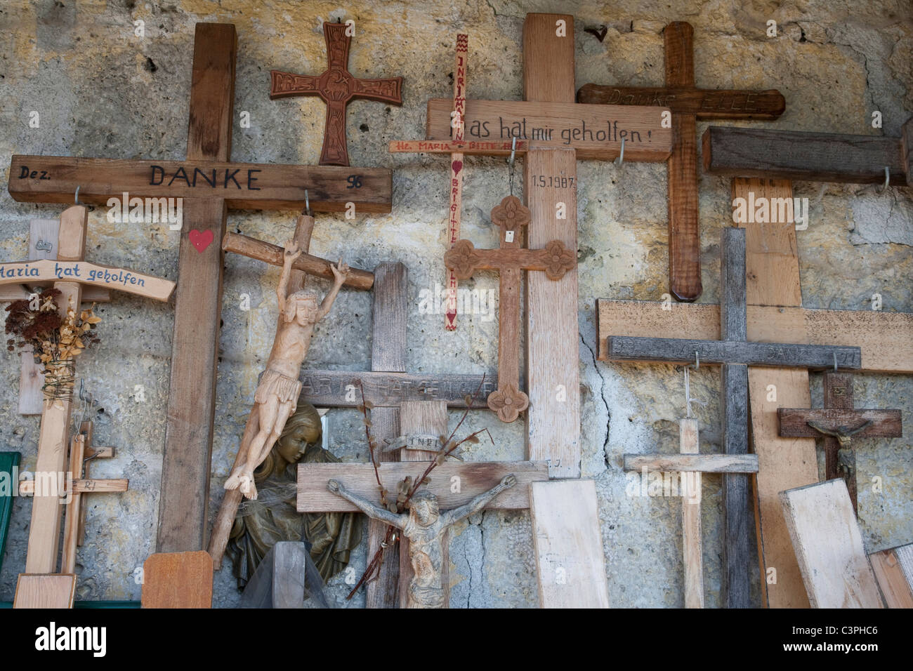 Germany, Bavaria, Pilgrimage Church Maria Eck, Votive crosses hanging on wall - Stock Image
