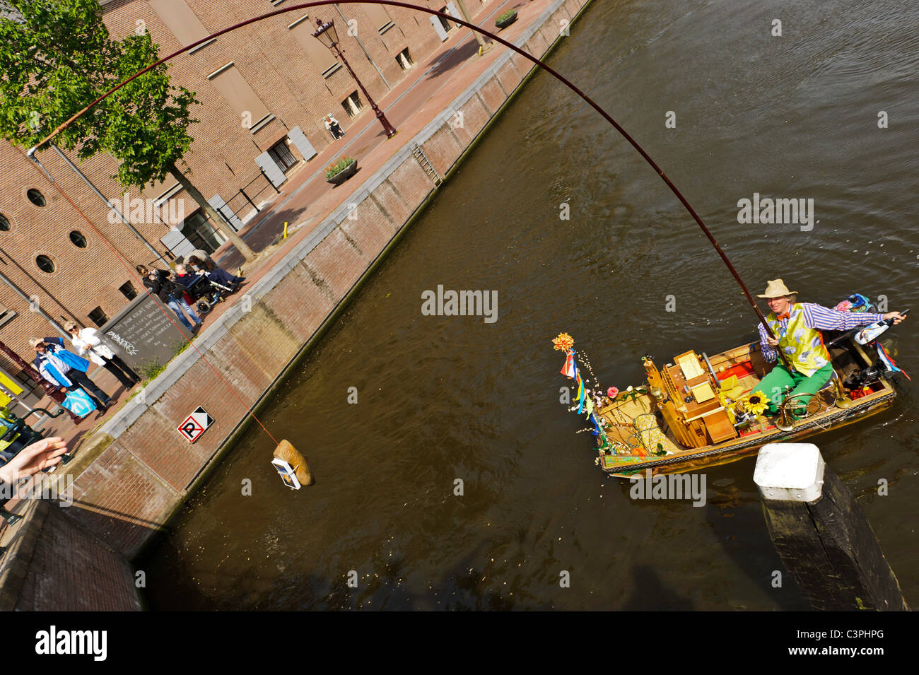Reinier Sijpkens plays the trumpet on an Amsterdam canal - Stock Image