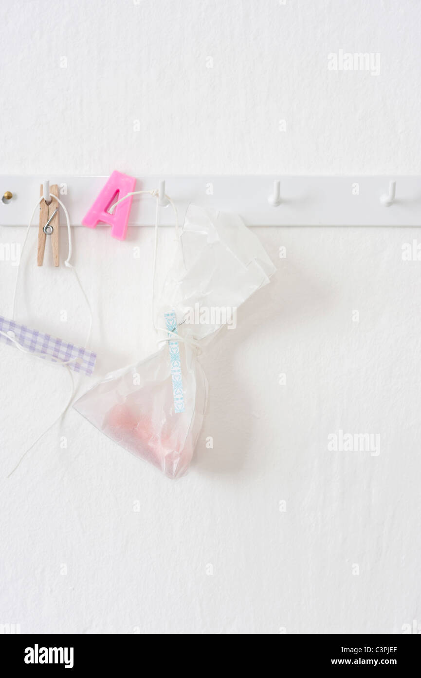 Pastries in plastic bags hanging on hook rack - Stock Image