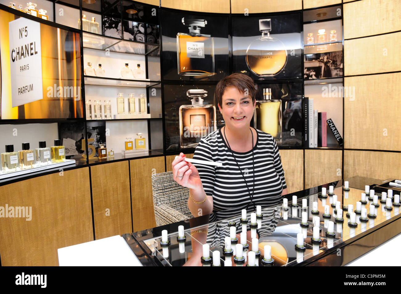 Chanel perfume consultant at Birmingham Airport duty free shop England Uk - Stock Image