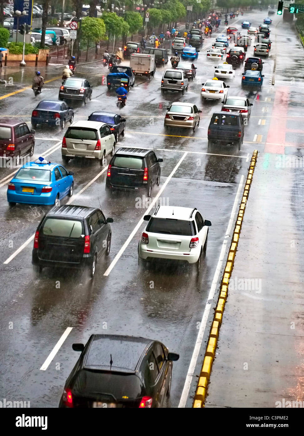 Crowded traffic jam in urban street in bad weather - Stock Image