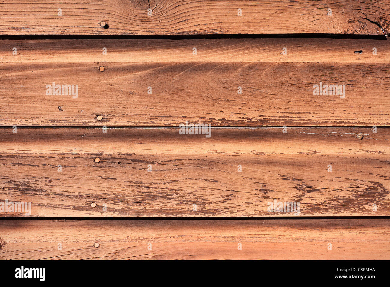 Some old and weathered wooden siding. - Stock Image