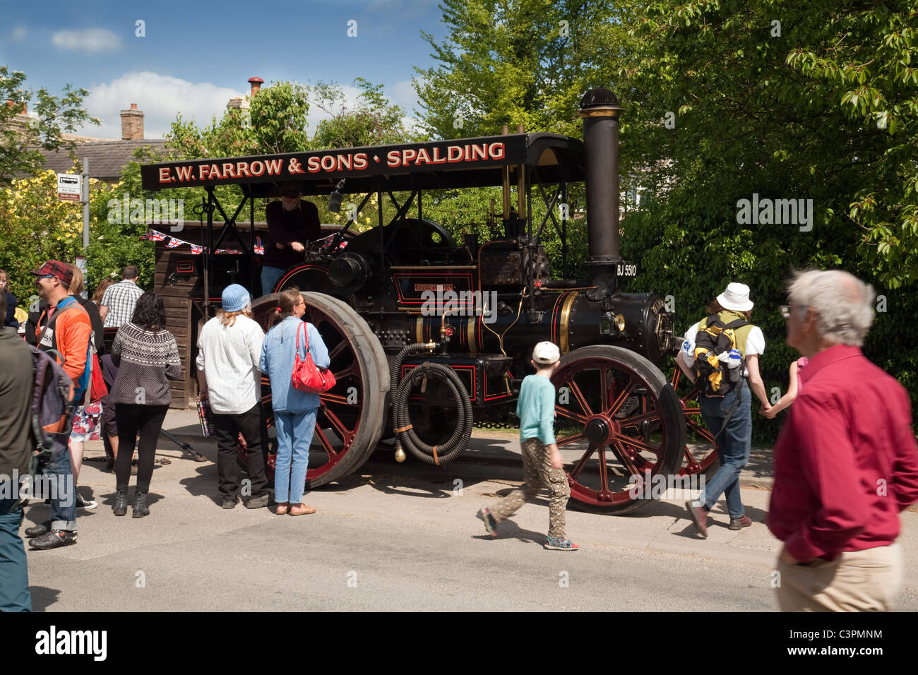 People looking at a Traction Engine, Reach village fair, Reach, Cambridgeshire UK - Stock Image