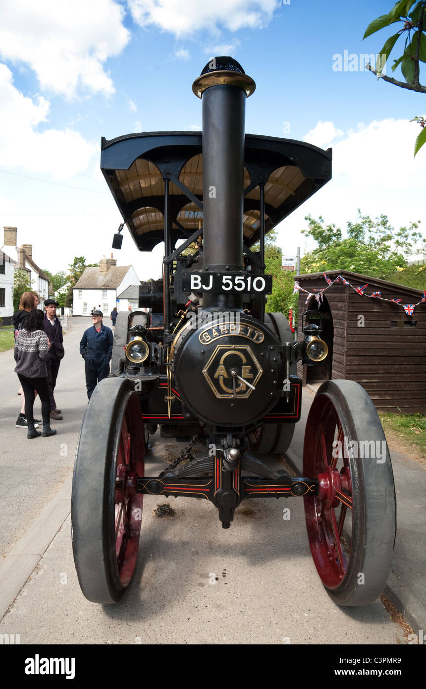 People looking at a Traction Engine at Reach Fair, Reach, Cambridgeshire UK - Stock Image