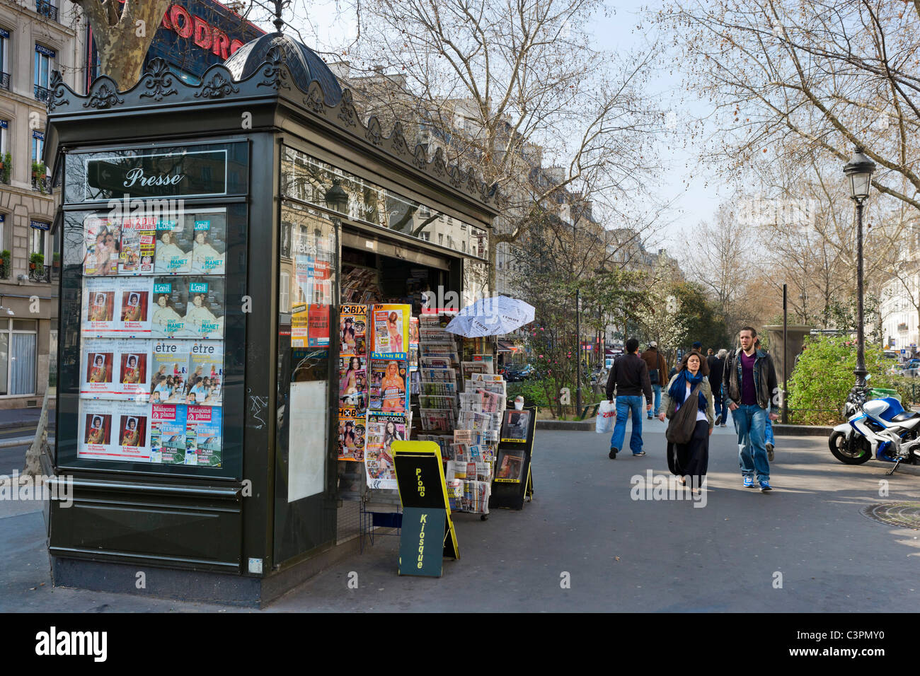 Typical newspaper kiosk on the Boulevard Rochechouart, Montmartre, Paris, France - Stock Image