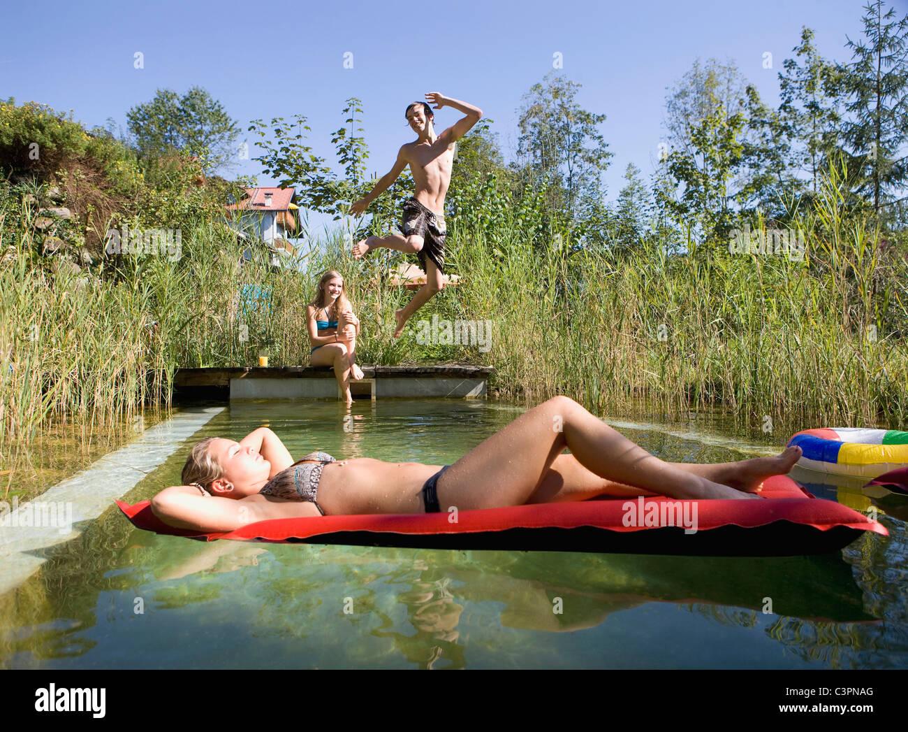 Teens having bareback by the pool