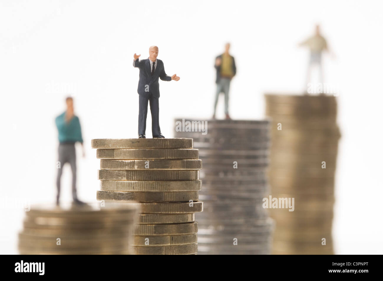 Businessman figurine planning about retirement pension - Stock Image