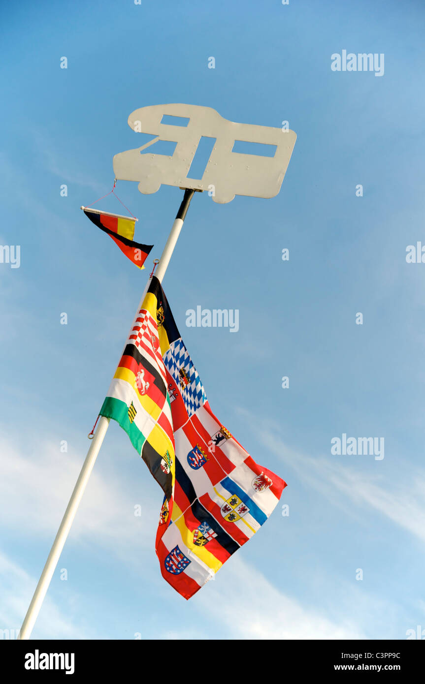 Pole with flags of the German provinces at the camper park in Stendorf (Saxony-Anhalt) - Stock Image