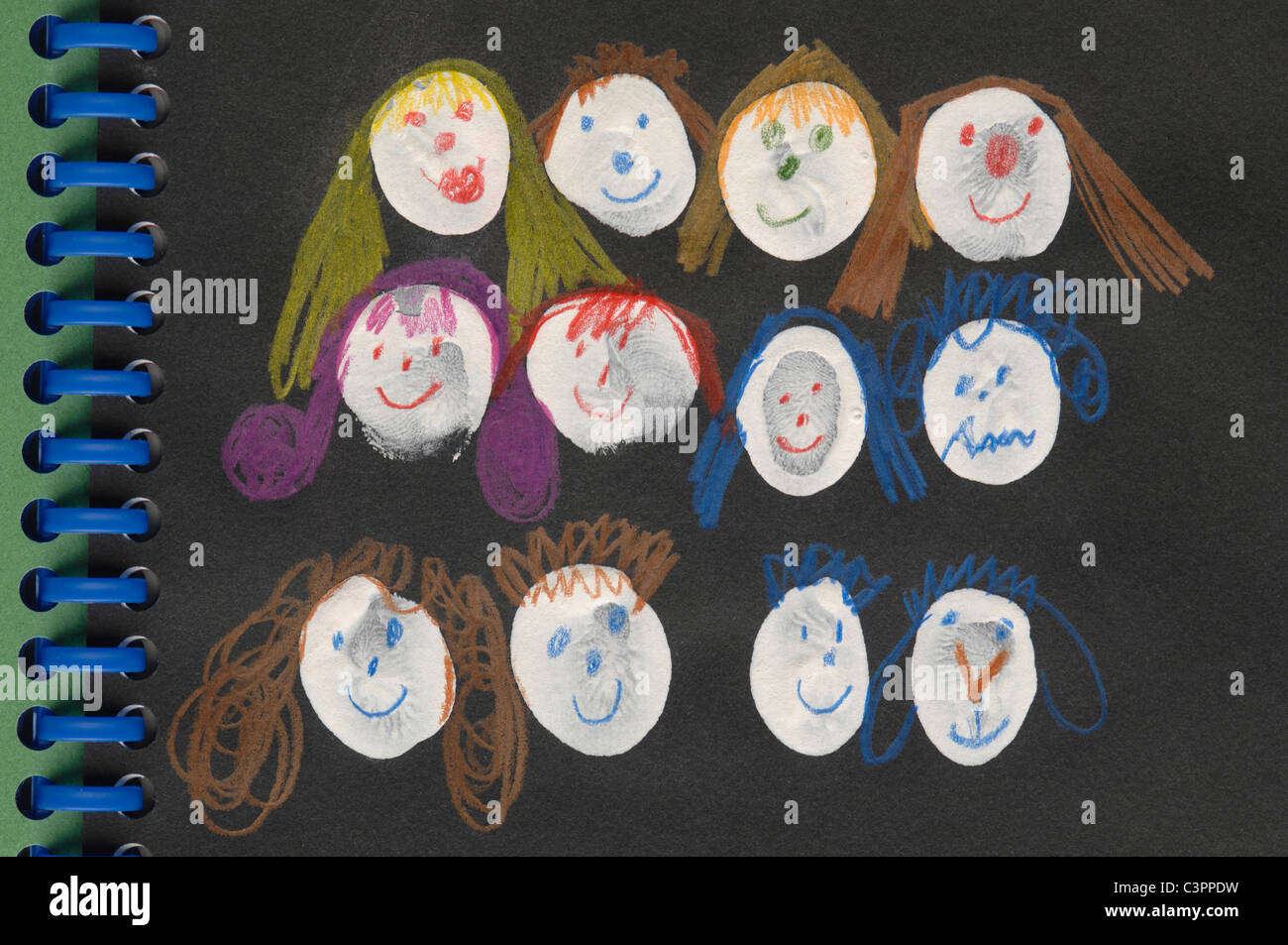 Germany, Munich, Variety of anthropomorphic faces in exercise book - Stock Image