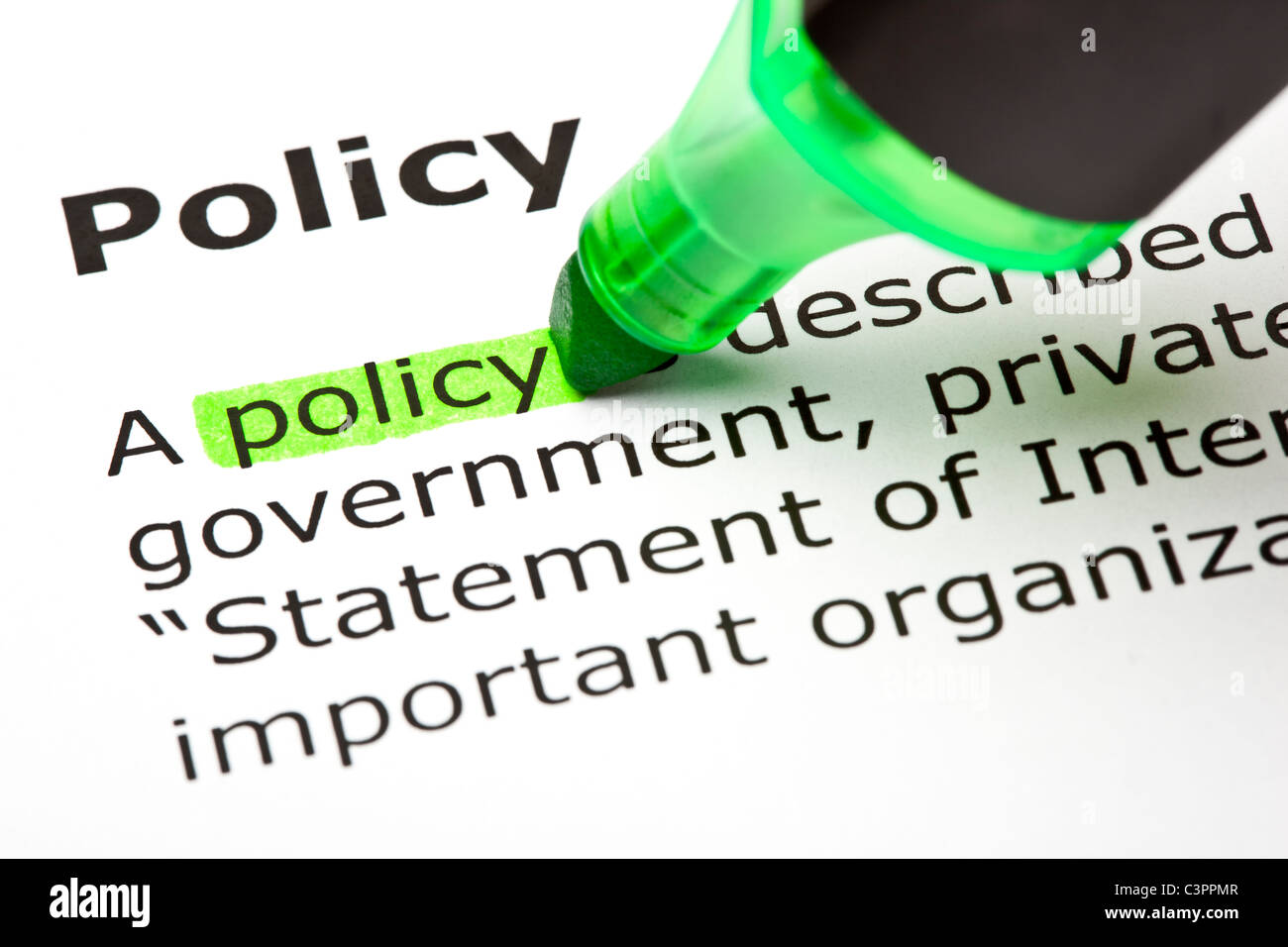 The word 'Policy' highlighted in green - Stock Image