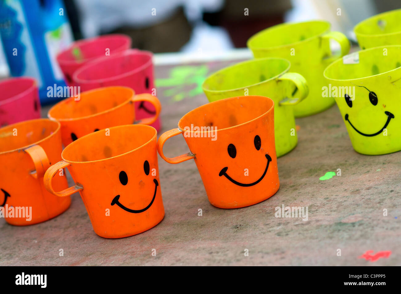 Plastic cups with a smily face, used for painting during a street theater festival in Almere (The Netherlands). - Stock Image