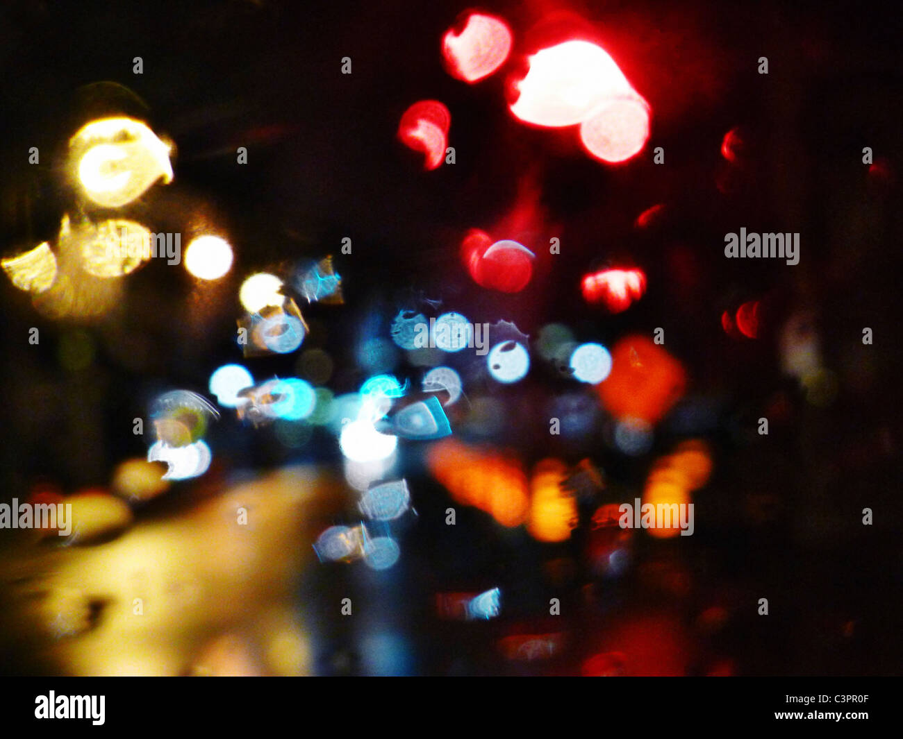 Blurry specular street lights at night. - Stock Image