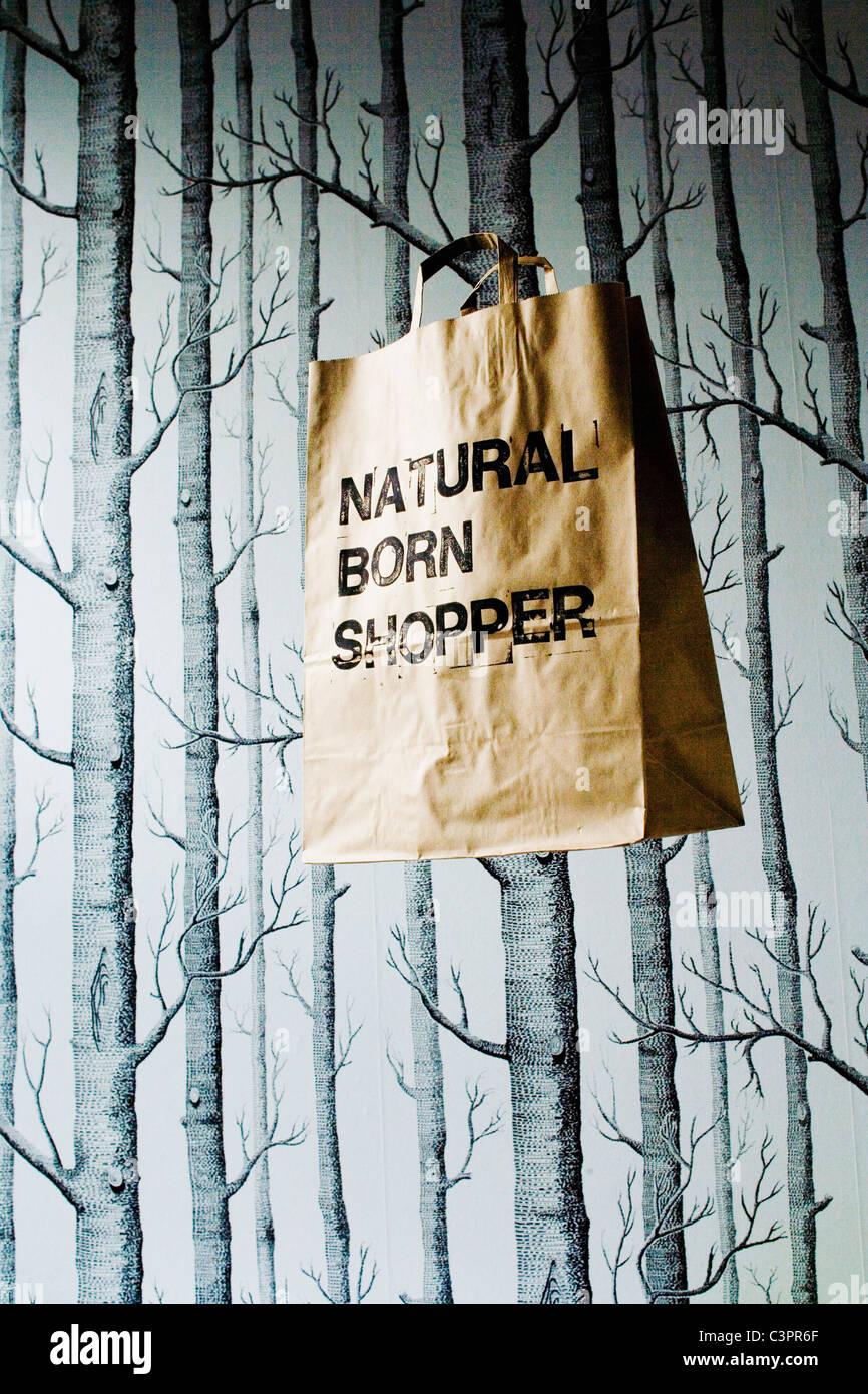 Brown paper bag hanging in studio - Stock Image