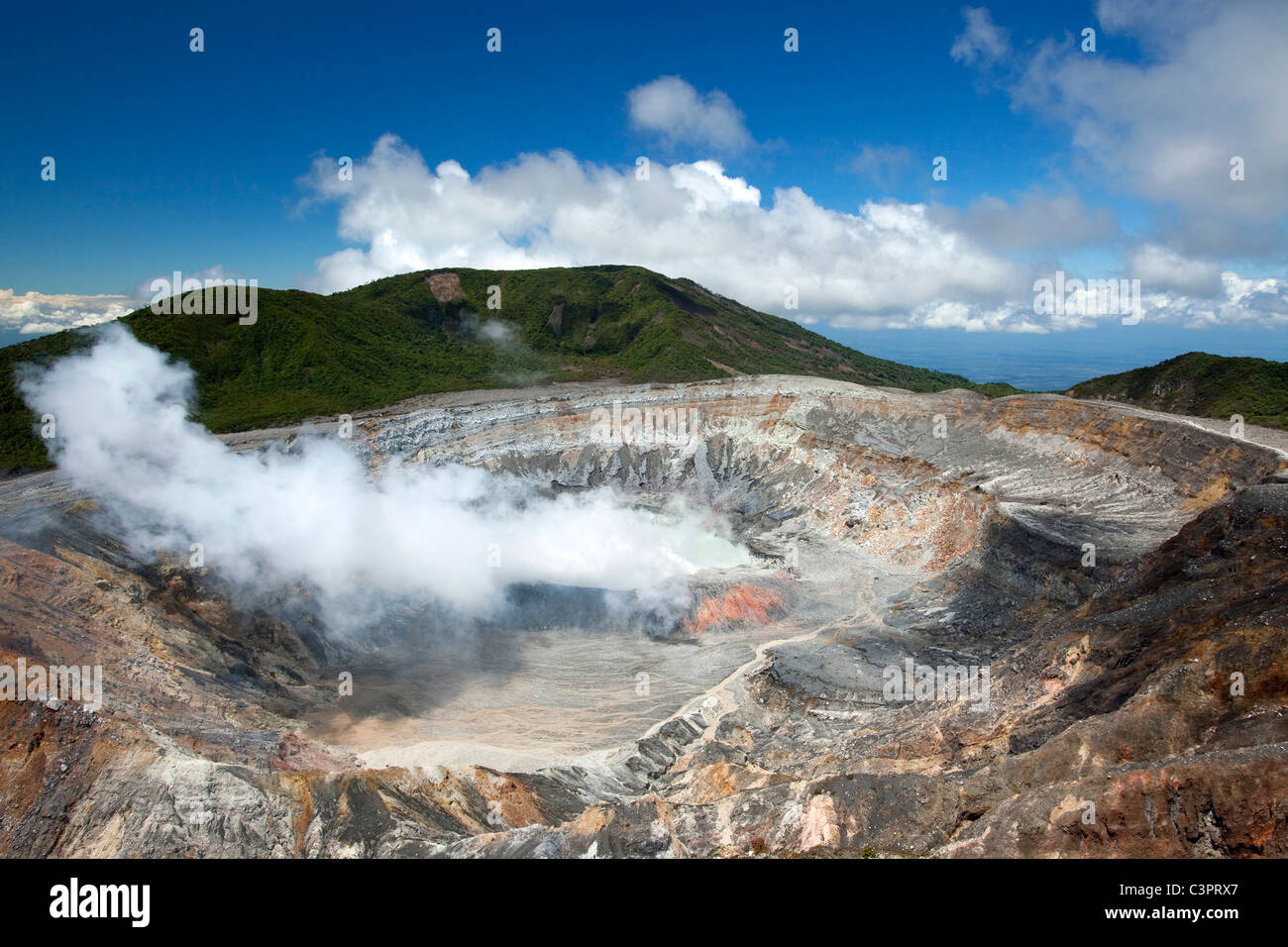 At the edge of an active crater volcano in Poas Volcano National Park in Costa Rica. - Stock Image