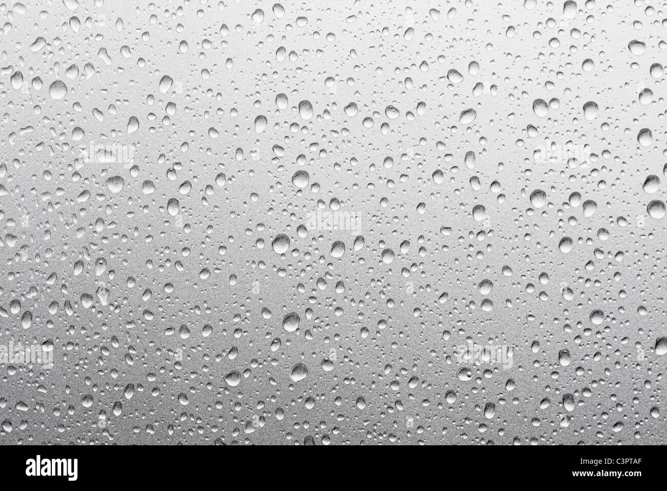Waterdrops on metallic-silver car , close up - Stock Image