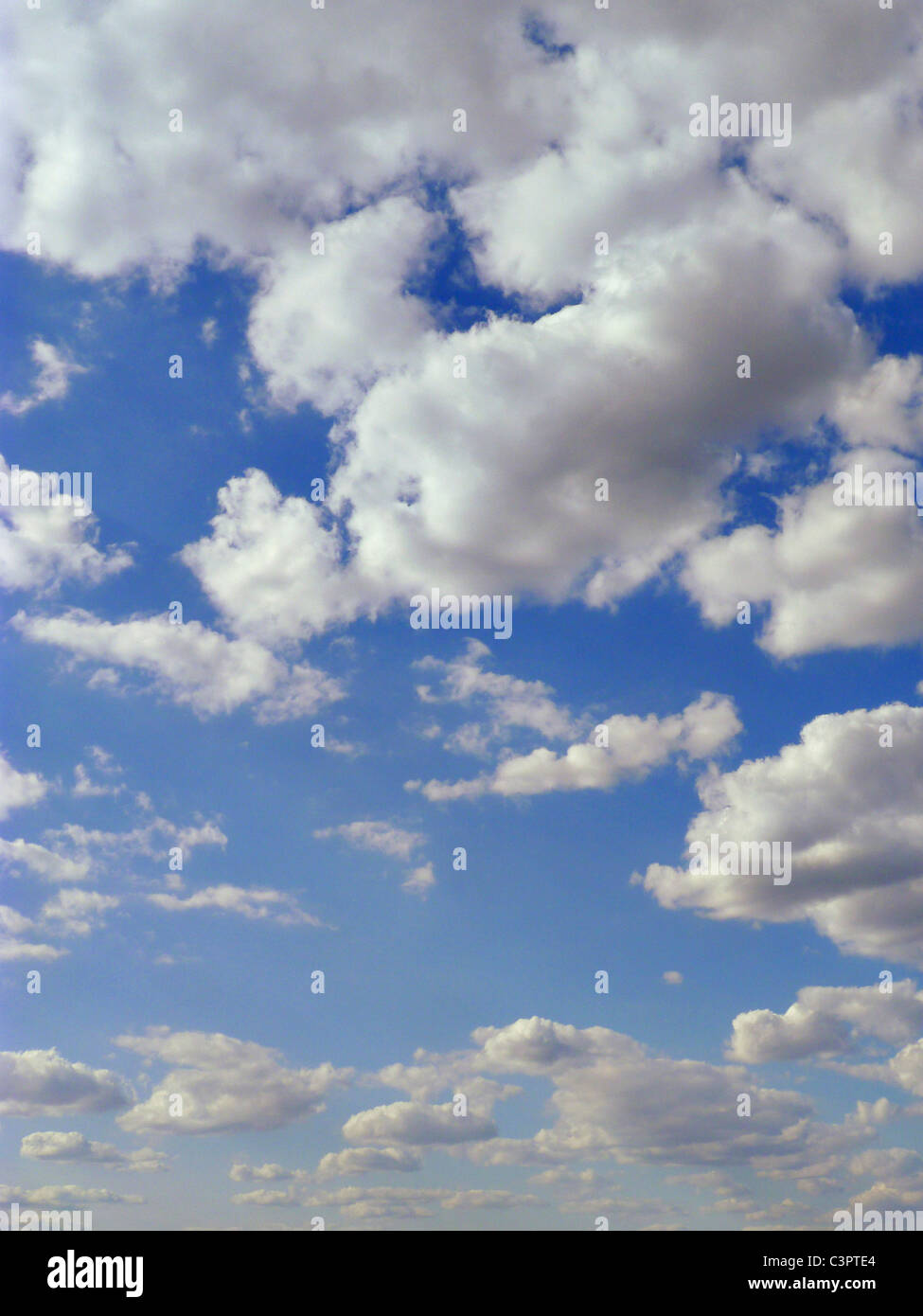 White puffy clouds. - Stock Image