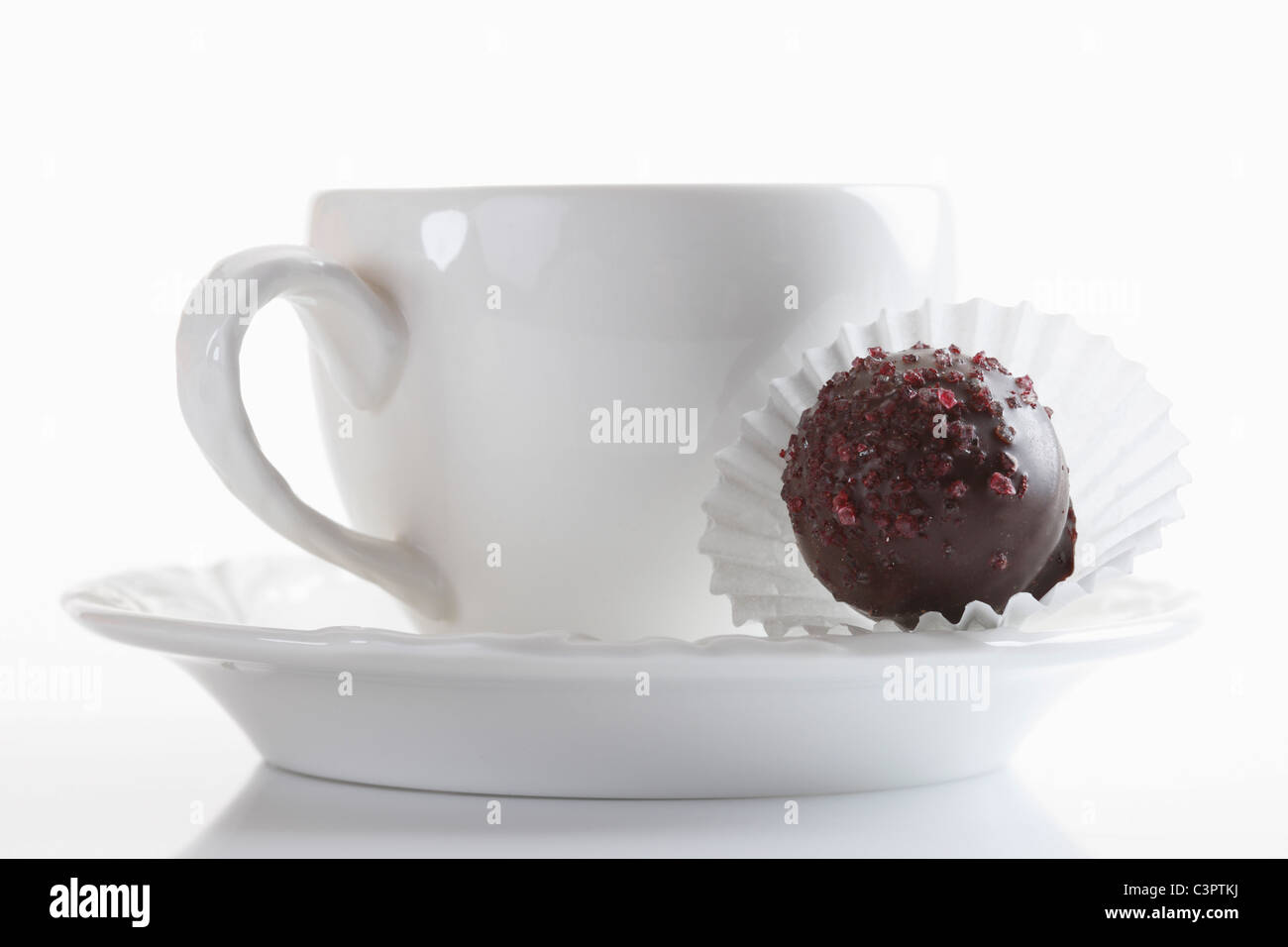 Coffee cup with chocolate on white background, close up - Stock Image