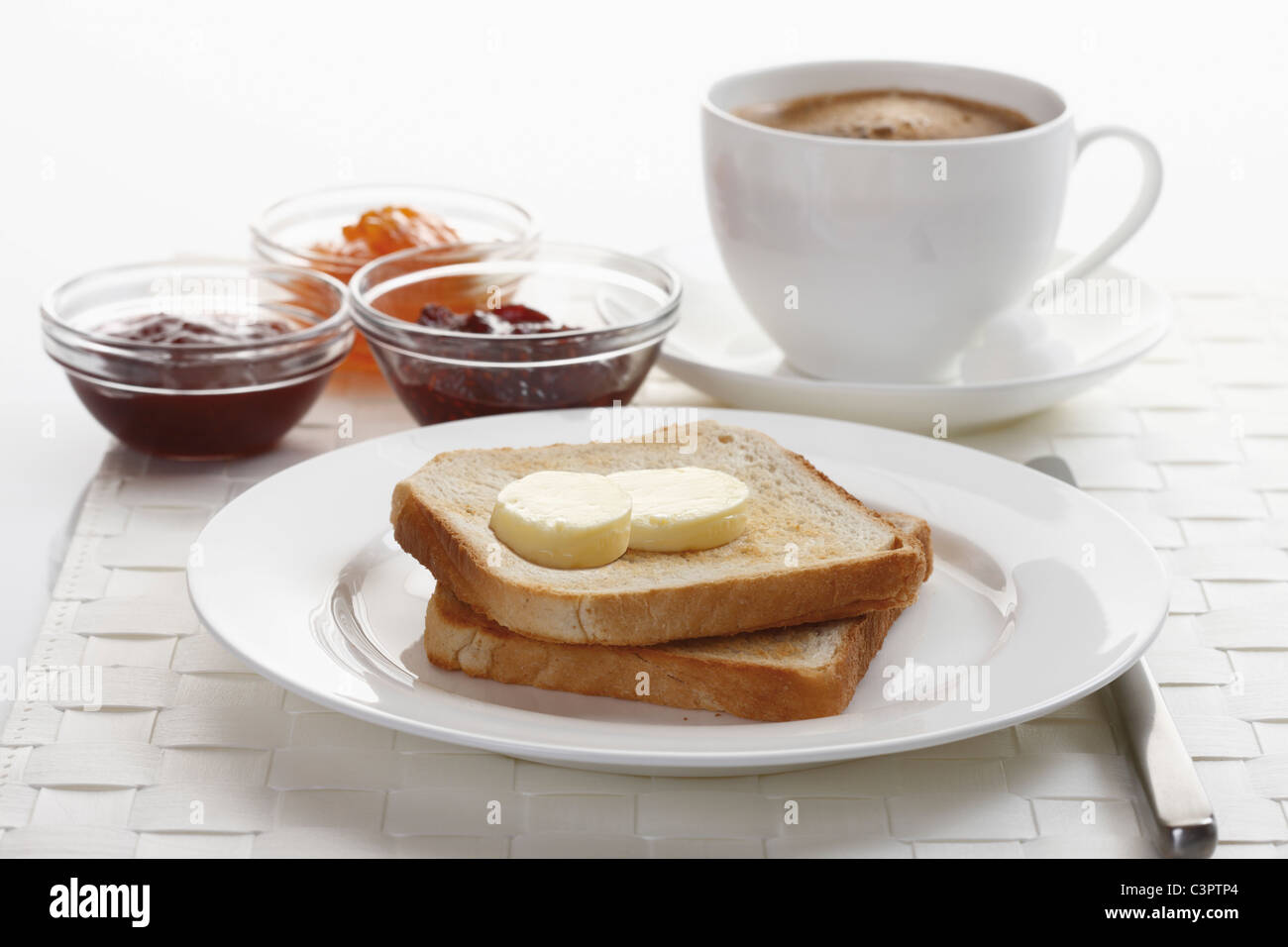 Ready breakfast on place mat, close up - Stock Image