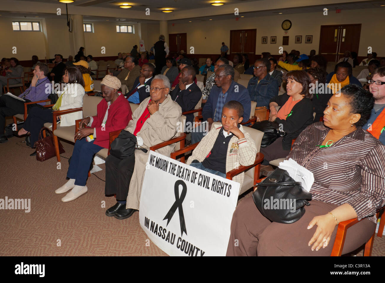 Boy with sign WE MOURN THE DEATH OF CIVIL RIGHTS IN NASSAU COUNTY, Ramel Smith Jr, Redistricting Hearing, May 9 - Stock Image