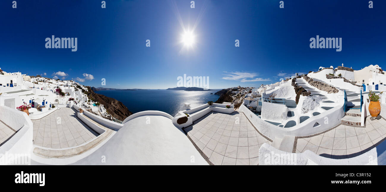 Greece, Cyclades, Thira, Santorini, Oia, View of blue dome and bell tower of a church with aegean sea - Stock Image