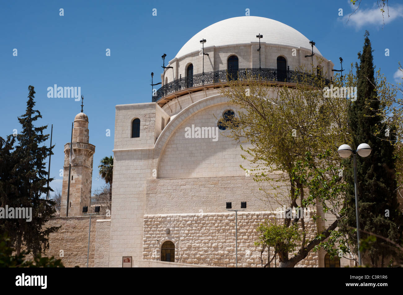 A Muslim minaret rises next to the dome of the Hurva Synagogue in the Jewish Quarter of the Old City of Jerusalem. - Stock Image