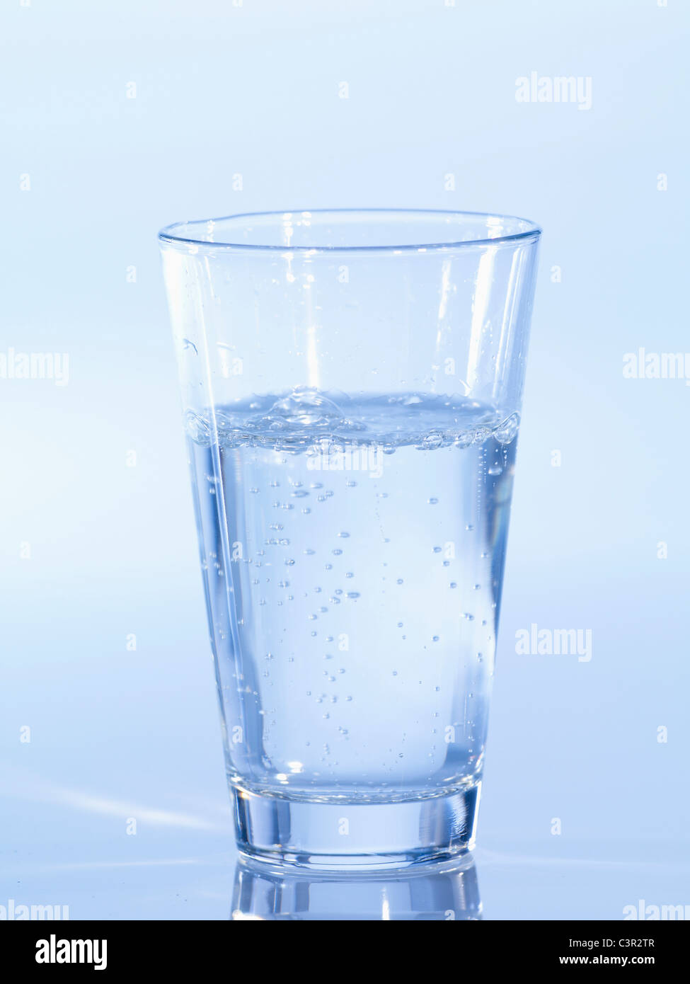 Fizzy glass of water, close-up - Stock Image