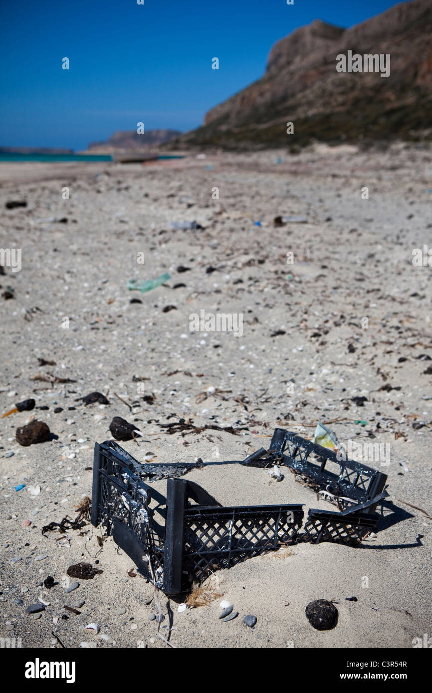 Plastic crate and tarballs from oil spills washed up on Balos Beach, on Gramvousa peninsula, in north western Crete, - Stock Image