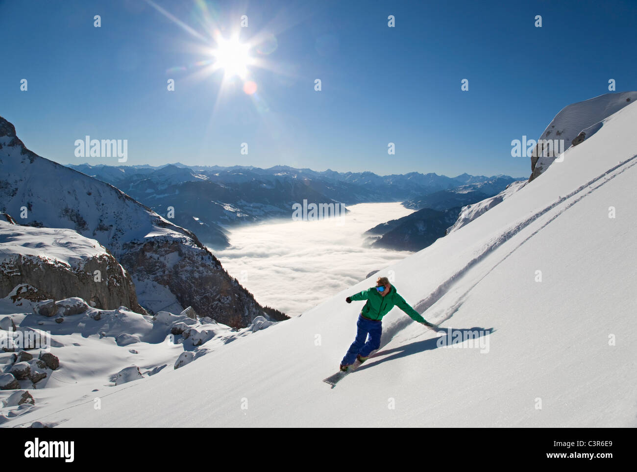 Snowboarder free riding - Stock Image