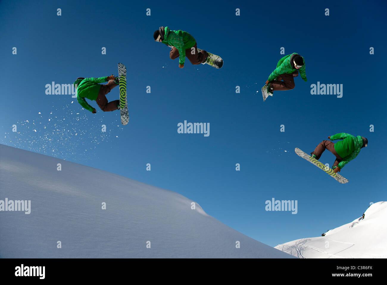 Snowboarder dangerous free ride jump Stock Photo