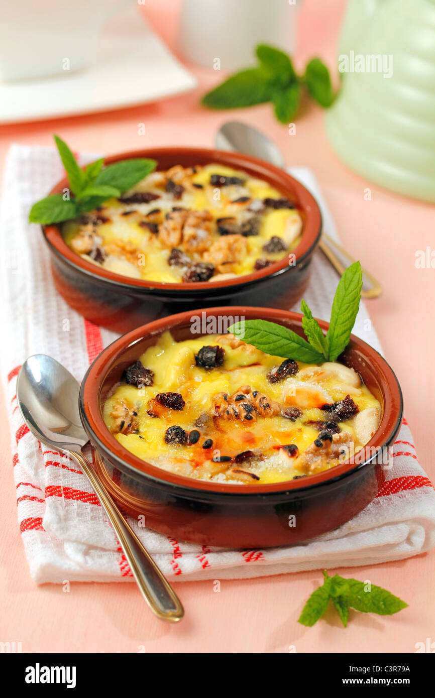 Custard with raisins and nuts. Recipe available. - Stock Image