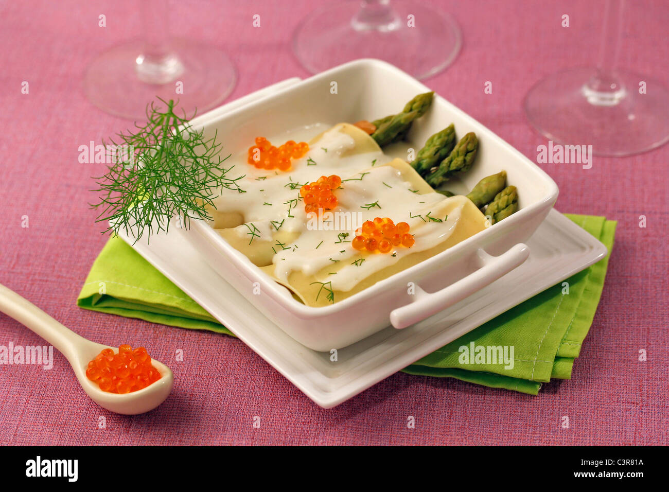 Light cannelloni with asparagus and salmon. Recipe available. Stock Photo