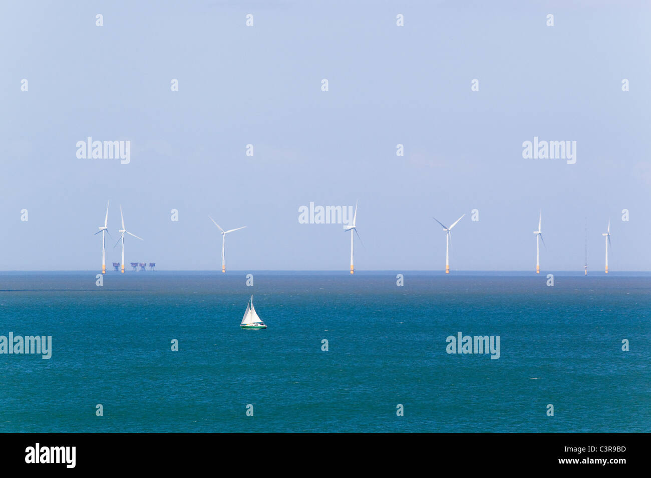 Kentish Flats wind turbine array and sailing boat, off Whitstable, Kent, UK. Shimering Sands maunsell fort is in - Stock Image