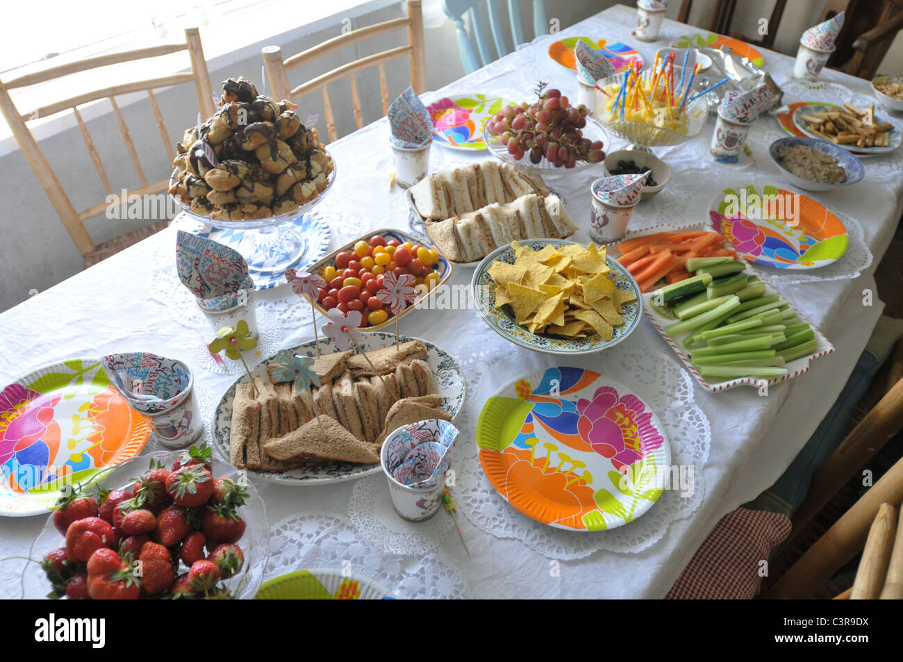 A table laid for a child's birthday party Stock Photo