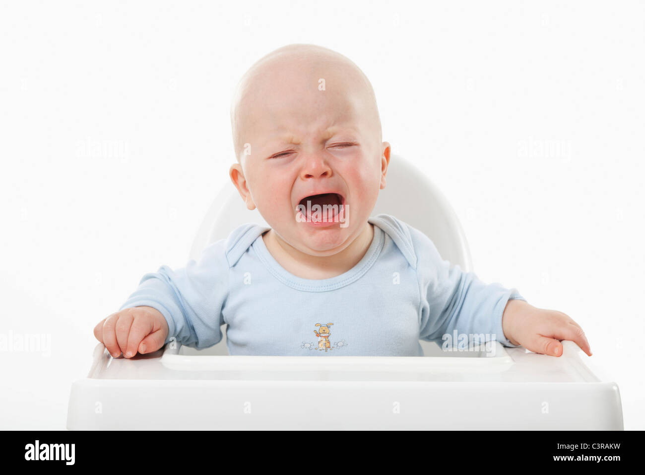 Baby boy (6- 11 Months) crying - Stock Image