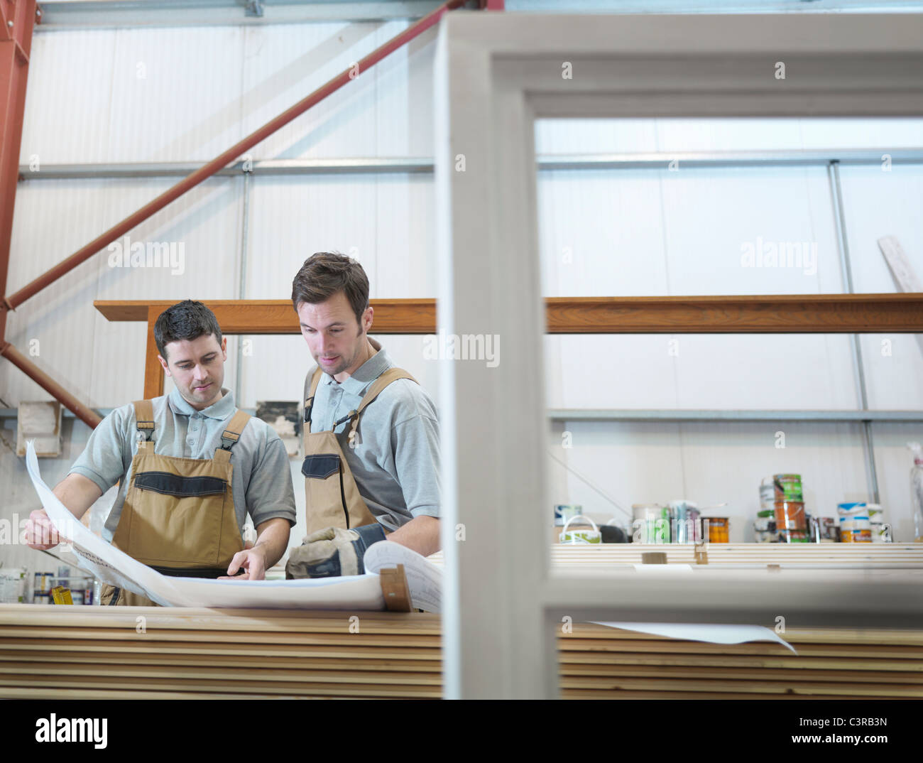 Woodworkers discussing plans - Stock Image