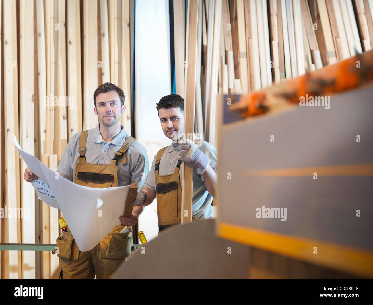 Woodworkers with timber - Stock Image