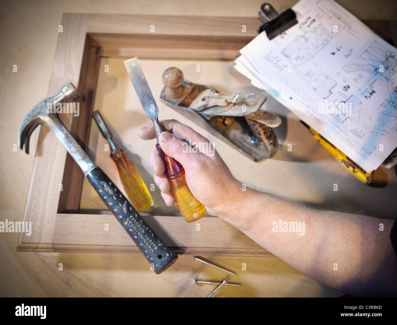 Hand holding woodworking tools - Stock Image