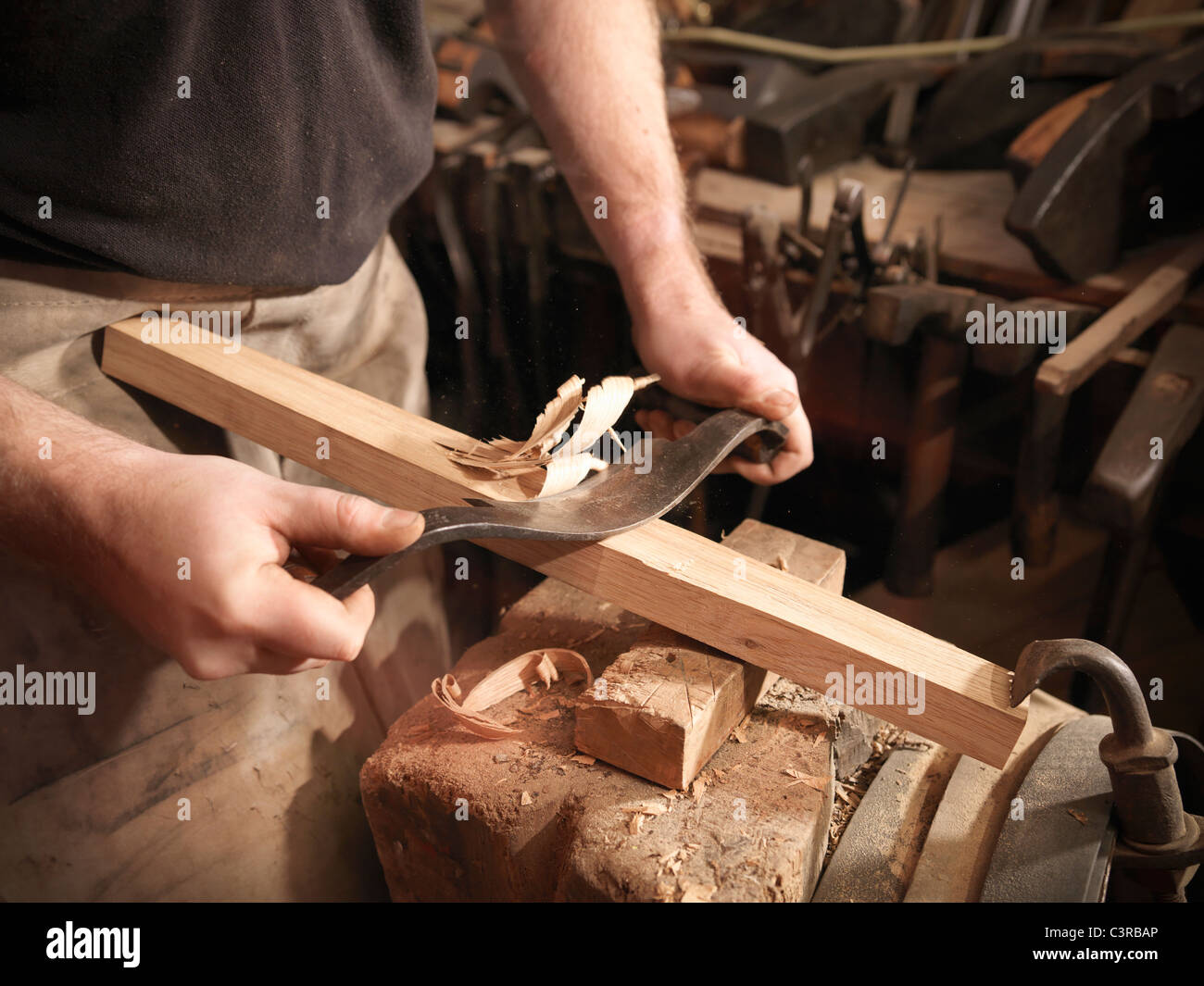 Cooper making a barrel with tools - Stock Image