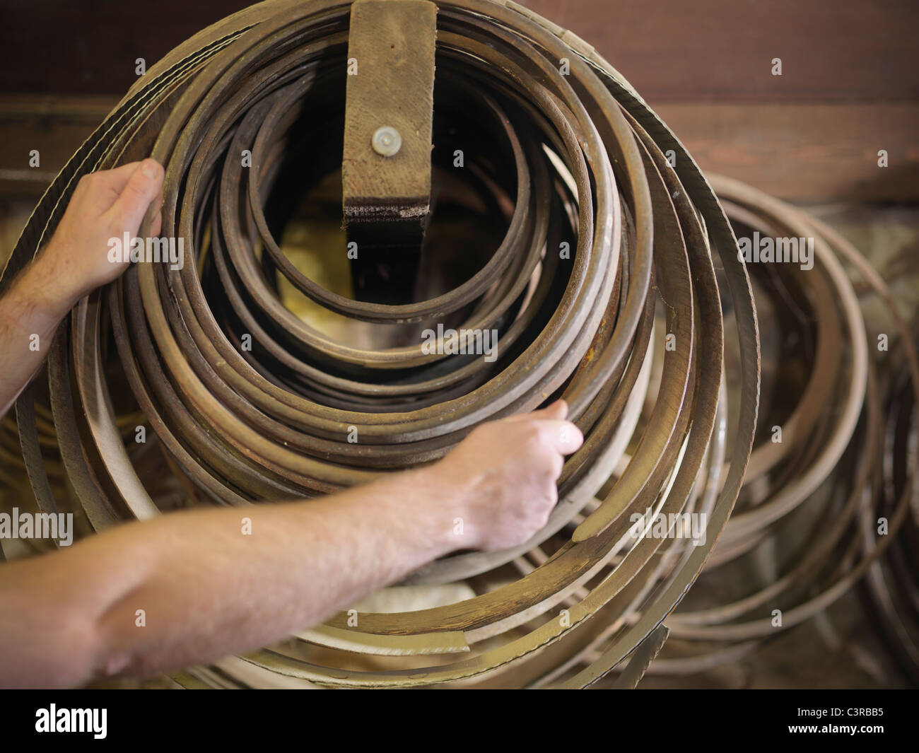 Worker with barrel parts in cooperage - Stock Image