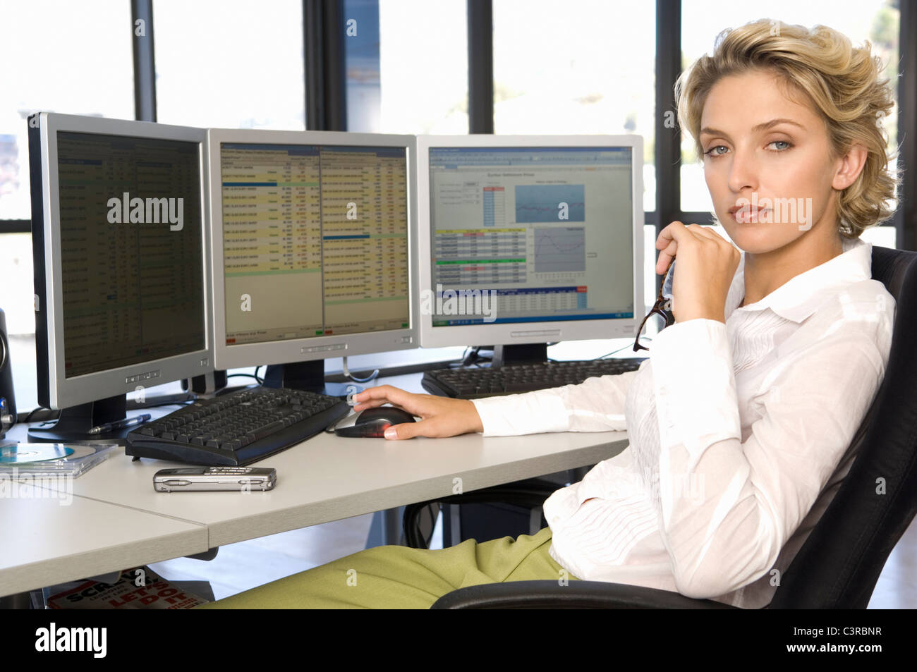Buisness woman at the computer - Stock Image