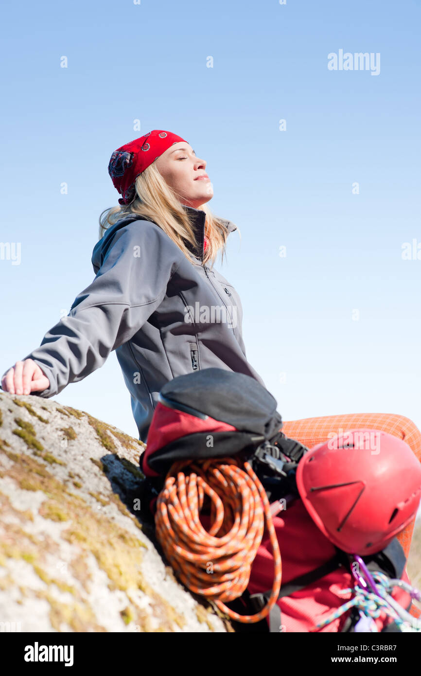 ad8471a8d99 Active young woman rock climbing relax with backpack on mountain ...